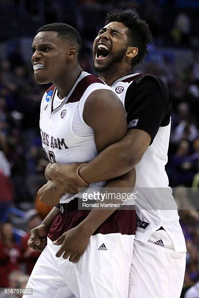 Danuel House of the Texas A&M Aggies celebrates with teammate Tonny Trocha-Morelos after defeating the Northern Iowa Panthers in double overtime with...