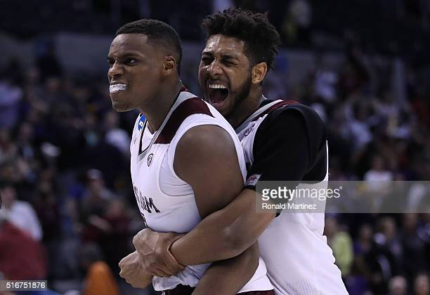 Danuel House of the Texas AM Aggies celebrates with teammate Tonny TrochaMorelos after defeating the Northern Iowa Panthers in double overtime with a...