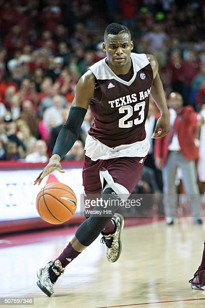 Danuel House of the Texas AM Aggies drives to the basket against the Arkansas Razorbacks at Bud Walton Arena on January 27 2016 in Fayetteville...
