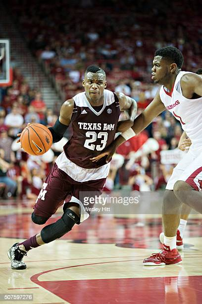 Danuel House of the Texas AM Aggies drives to the basket against Trey Thompson of the Arkansas Razorbacks at Bud Walton Arena on January 27 2016 in...