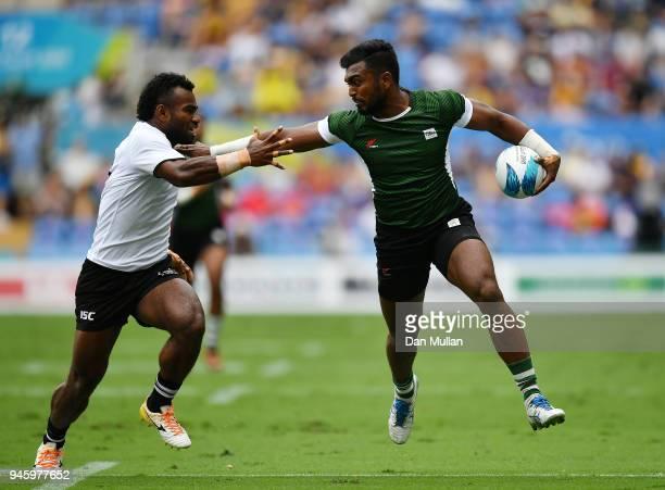 Danushka Wijekoon of Sri Lanka takes on Amenoni Nasilasila of Fiji during Rugby Sevens Men's Pool D match between Fiji and Sri Lanka on day 10 of the...