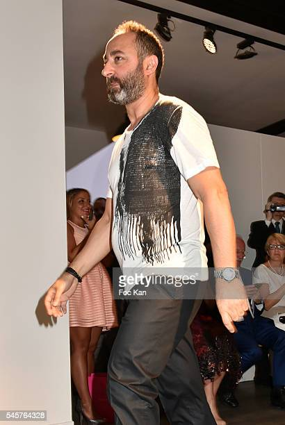 Dany Atrache walks the runway during the Dany Atrache Haute Couture Fall/Winter 20162017 show as part of Paris Fashion Week on July 4 2016 in Paris...