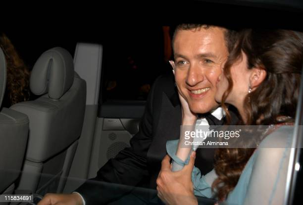 Dany Boon and guest during 2005 Cannes Film Festival 'Joyeux Noël' Departures at Palais de Festival in Cannes France