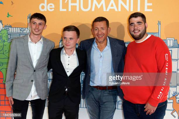 """Dany Boon, Léo, Wilfried and Franck attend the photocall for the premiere of """"8 rue de l'Humanité"""" on September 24, 2021 in Vitry-en-Artois near..."""