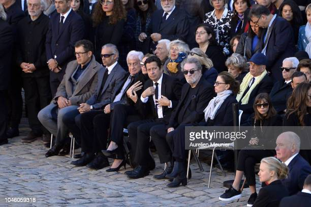 Dany Boon Paul Belmondo Jean Paul Belmondo Laurent Gerra and Eddy Mitchell attend the national tribute to Charles Aznavour at Les Invalides on...