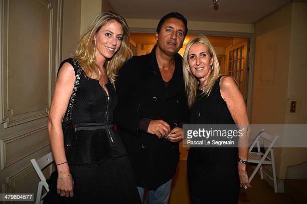 Dany Brillant and his girlfriend Nathalie pose with Regine Mahaux during the Rivoli Party on March 20 2014 in Paris France