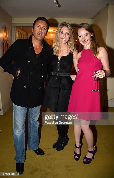 Dany Brillant poses with his girlfriend Nathalie and Deborah Francois during the Rivoli Party on March 20 2014 in Paris France
