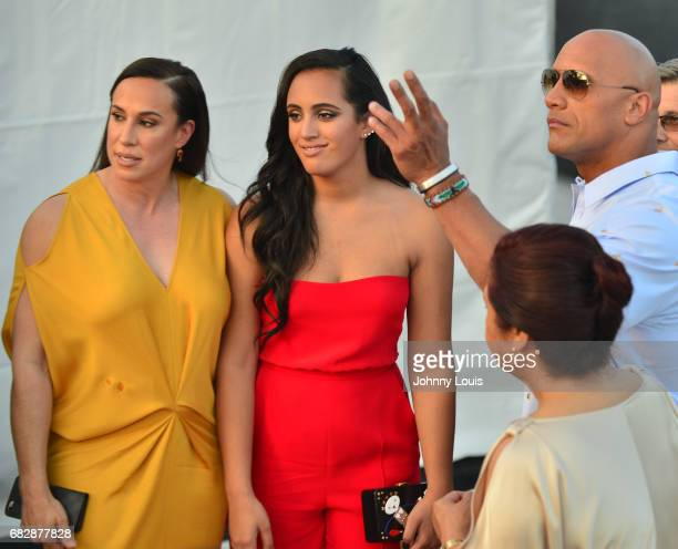 Dany Garcia Simone Alexandra Johnson Dwayne Johnson and Ata Johnson attend Paramount Pictures' World Premiere of 'Baywatch' on May 13 2017 in Miami...