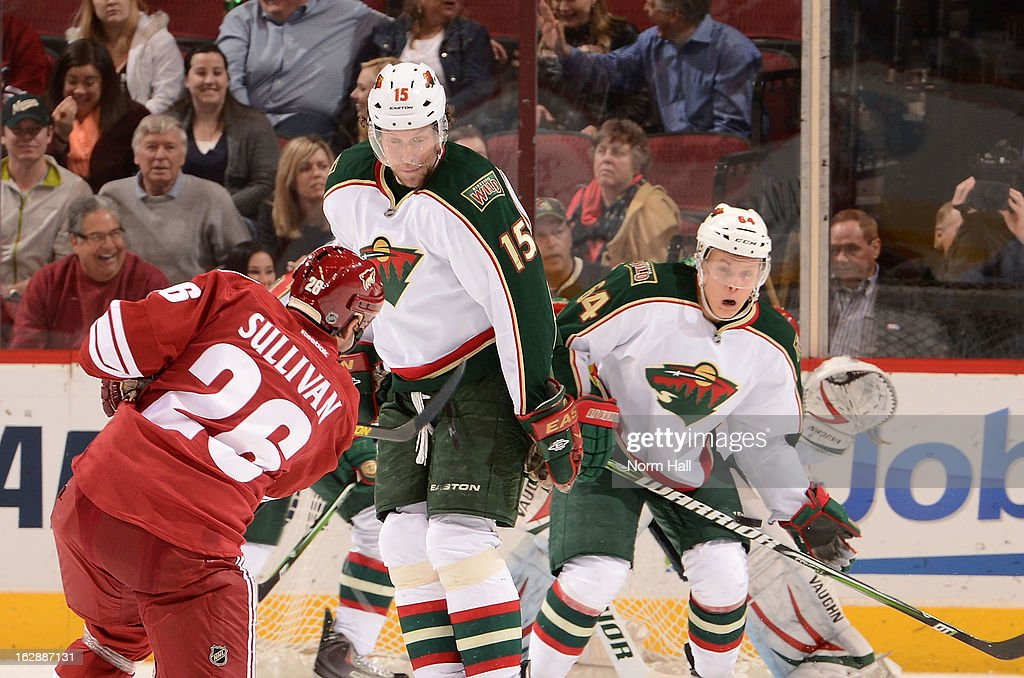 Dany Heatley #15 and Mikael Granlund #64 of the Minnesota Wild look to block the shot of Steve Sullivan #26 of the Phoenix Coyotes during the third period at Jobing.com Arena on February 28, 2013 in Glendale, Arizona.