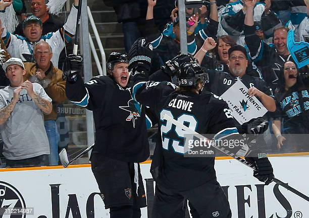 Dany Heatley and Ryane Clowe of the San Jose Sharks celebrate Heatley's first period goal against the Los Angeles Kings in Game 1 of the Western...