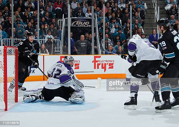 Dany Heatley and Ryane Clowe of the San Jose Sharks try to get a rebound against Jonathan Quick and Matt Greene of the Los Angeles Kings in Game 1 of...