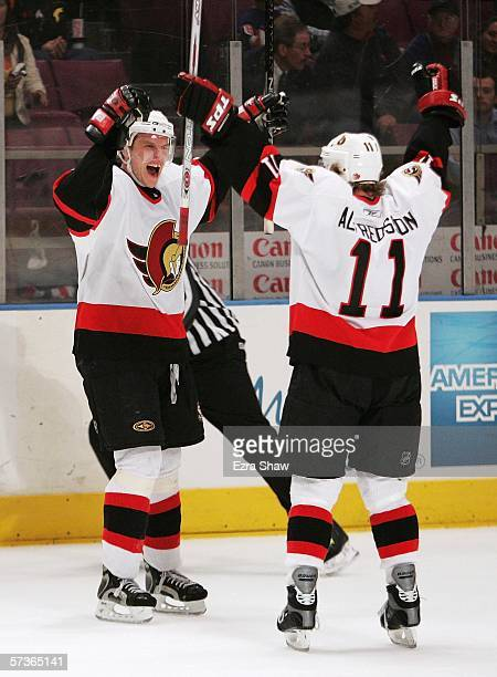 Dany Heatley is congratulated by teammate Daniel Alfredsson of the Ottawa Senators after Heatley scored to make it 51 over the New York Rangers on...