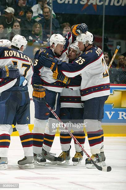 Dany Heatley, Marc Savard and Andy Sutton of the Atlanta Thrashers celebrate against the Vancouver Canucks during the game at General Motors Place on...