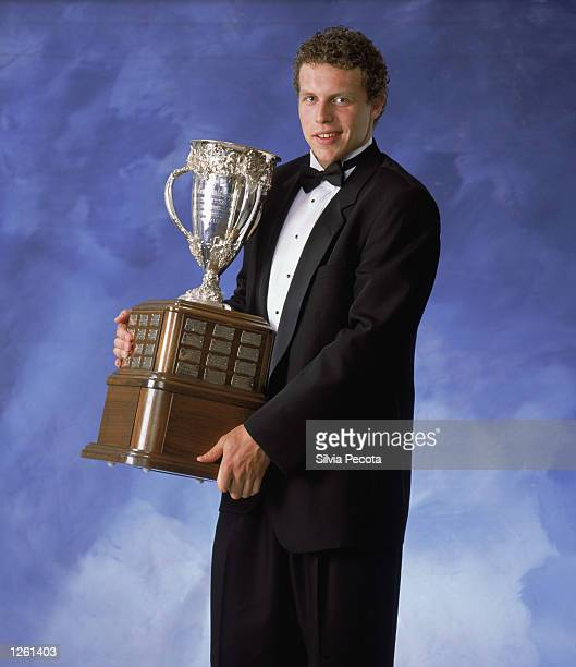 Dany Heatley of the Atlanta Thrashers poses for a studio portrait with the Calder Memorial trophy for Outstanding Rookie during the NHL Awards in the...