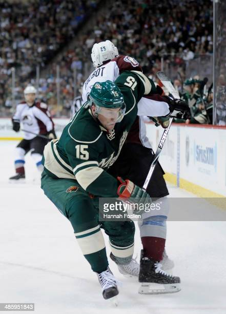 Dany Heatley of the Minnesota Wild and Maxime Talbot of the Colorado Avalanche get tied up during the first period in Game Three of the First Round...