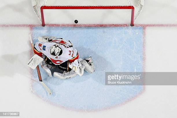 Dany Heatley of the Minnesota Wild scores a goal against Miikka Kiprusoff of the Calgary Flames during the game at the Xcel Energy Center on March 22...