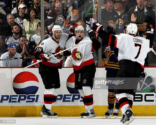 Dany Heatley of the Ottawa Senators celebrates his goal with teammates Jason Spezza and Joe Corvo during the second period of Game 5 of the 2007...