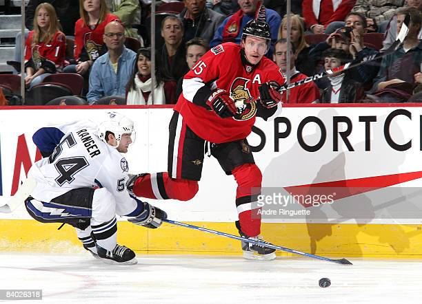 Dany Heatley of the Ottawa Senators passes the puck against pressure from Paul Ranger of the Tampa Bay Lightning at Scotiabank Place on December 13...