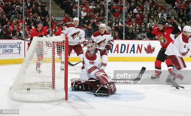 Dany Heatley of the Ottawa Senators scores a goal against Ilya Bryzgalov of the Phoenix Coyotes at Scotiabank Place on October 17 2008 in Ottawa...