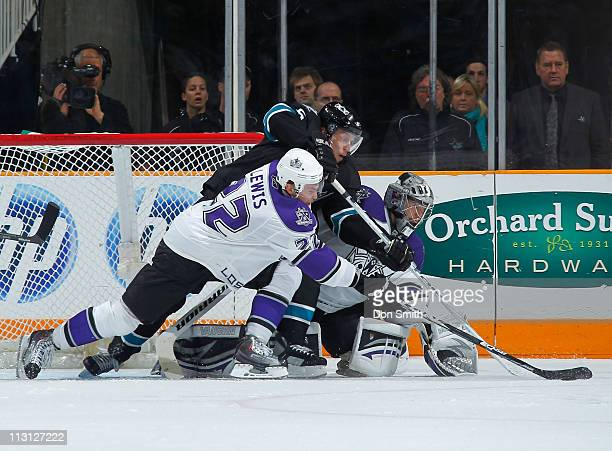Dany Heatley of the San Jose Sharks battles for the puck against Trevor Lewis and Jonathan Quick of the Los Angeles Kings in Game 5 of the Western...