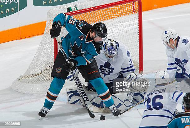 Dany Heatley of the San Jose Sharks looks for the puck against James Reimer of the Toronto Maple Leafs during an NHL game on January 11, 2011 at HP...