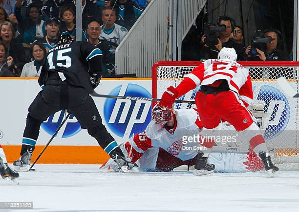 Dany Heatley of the San Jose Sharks looks to shoot on a break away against Jimmy Stewart and Valtteri Filppula of the Detroit Red Wings in Game Five...