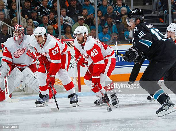 Dany Heatley of the San Jose Sharks pursues the puck against Henrik Zetterberg, Jonathan Ericsson, and Jimmy Howard of the Detroit Red Wings in Game...