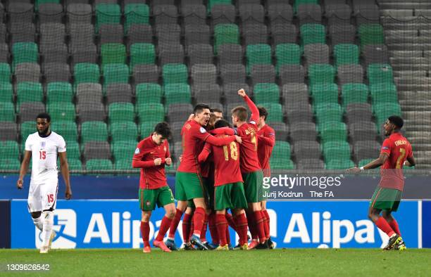 Dany Mota of Portugal celebrates with team mates after scoring their side's first goal during the 2021 UEFA European Under-21 Championship Group D...