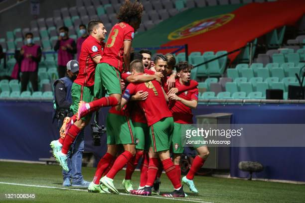 Dany Mota of Portugal celebrates with team mates after scoring to give the side a 1-0 lead during the 2021 UEFA European Under-21 Championship...