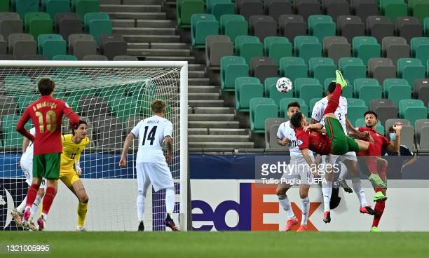 Dany Mota of Portugal scores their side's first goal past Marco Carnesecchi of Ital during the 2021 UEFA European Under-21 Championship...