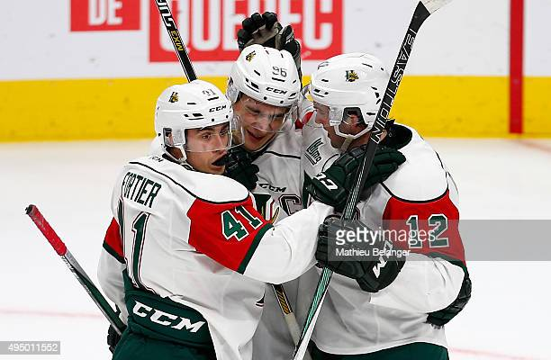 Dany Moynihan of the Halifax Mooseheads celebrates his goal with teammates Maxime Fortier and Timo Meier against the Quebec Remparts during the CHL...