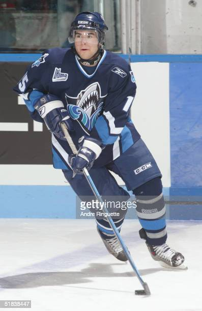 Dany Roussin of Rimouski Oceanique looks to make a play with the puck in the neutral zone against the Gatineau Olympiques during the Quebec Major...