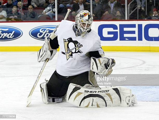 Dany Sabourin of the Pittsburgh Penguins makes a glove save on his way to a shutout victory againt the New Jersey Devils during their game at the...