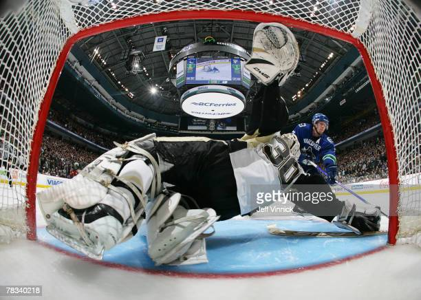 Dany Sabourin of the Pittsburgh Penguins makes a save off the shot of Brendan Morrison of the Vancouver Canucks during their game at General Motors...
