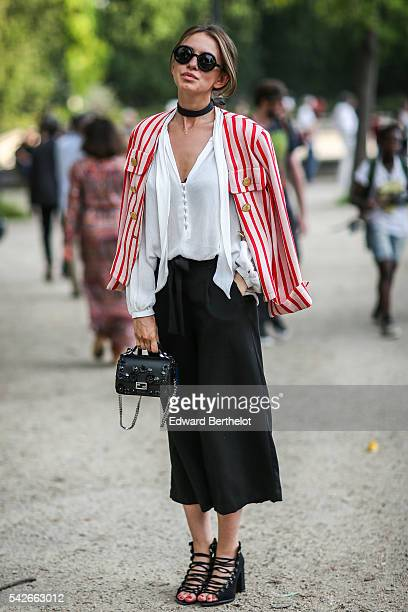 Danya @cosmicheskoe is wearing a Saint Laurent white and red jacket and a Furla bag outside the Dries Van Noten show during Paris Fashion Week...
