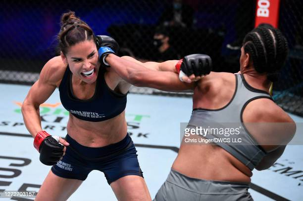 Danyelle Wolf punches Taneisha Tennant in their women's featherweight bout during week seven of Dana White's Contender Series season four at UFC APEX...