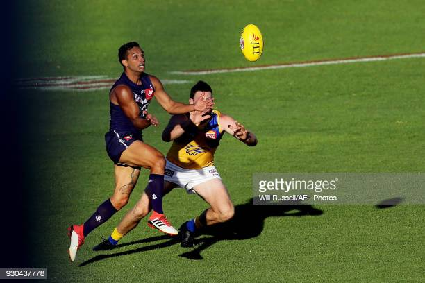 Danyle Pearce of the Dockers and Jeremy McGovern of the Eagles go to mark the ball during the JLT Community Series AFL match between the Fremantle...