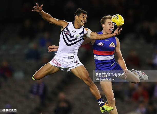 Danyle Pearce of the Dockers and Lachie Hunter of the Bulldogs contest for the ball during the round three AFL NAB Challenge match between the...