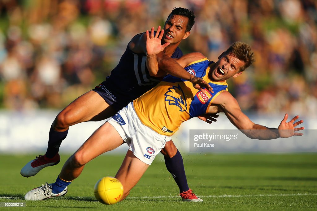 Danyle Pearce of the Dockers and Mark LeCras of the Eagles contest for the ball during the JLT Community Series AFL match between the Fremantle Dockers and the West Coast Eagles at HBF Arena on March 11, 2018 in Perth, Australia.