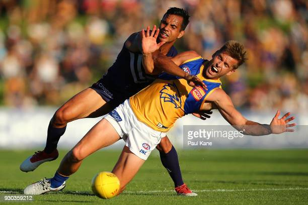Danyle Pearce of the Dockers and Mark LeCras of the Eagles contest for the ball during the JLT Community Series AFL match between the Fremantle...
