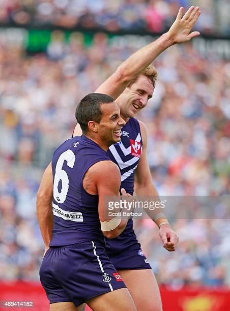 Danyle Pearce of the Dockers celebrates after kicking a goal with Michael Barlow during the round two AFL match between the Geelong Cats and the...
