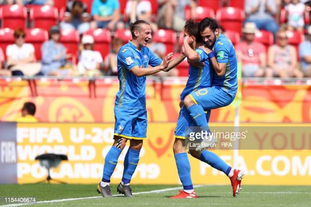 Danylo Sikan of Ukraine celebrates with team mates after scoring their team's first goal during the 2019 FIFA U20 World Cup Quarter Final match...