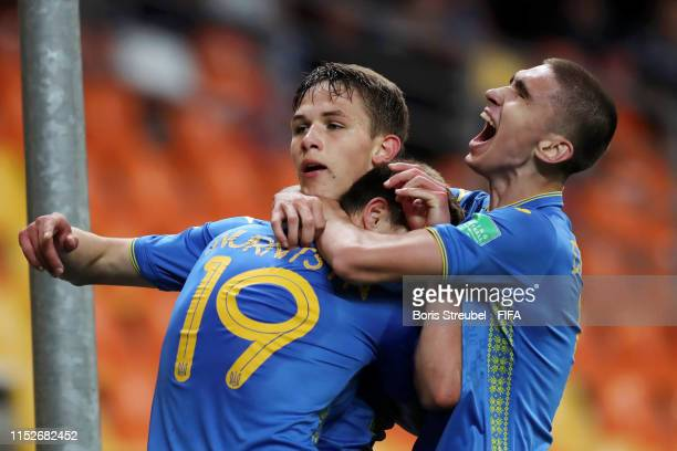 Danylo Sikan of Ukraine celebrates with teammates after scoring his team's first goal during the 2019 FIFA U20 World Cup group D match between...