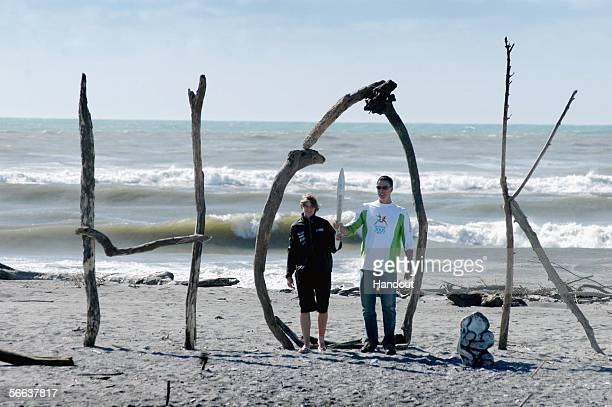 Danyon Loader and Jane Maley a member of New Zealand's hockey squad walk the baton to the beach as the baton makes it way to Hokitika on the West...