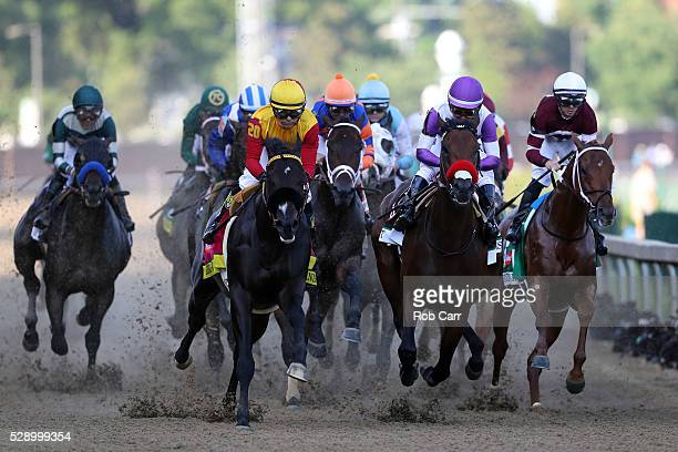 Danzing Candy ridden by Mike E Smith and Nyquist ridden by Mario Gutierrez lead the field during the 142nd running of the Kentucky Derby at Churchill...