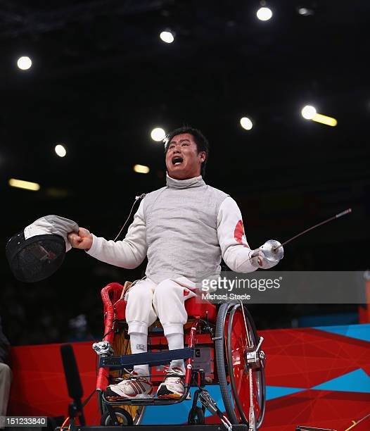 Daoliang Hu of China celebrates winning gold against Anton Datsko of Ukraine during the Men's Individual Foil Category B final of the Wheelchair...