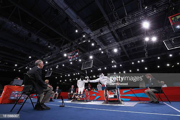 Daoliang Hu of China competes against Damien Tokatlian of France during the Men's Team Catagory Open Wheelchair Fencing Final on day 10 of the London...