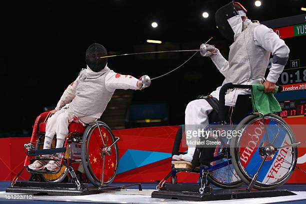 Daoliang Hu of China in action against Marat Yusupov of Russia in the Men's Individual Foil quarter final match during the Wheelchair Fencing on day...