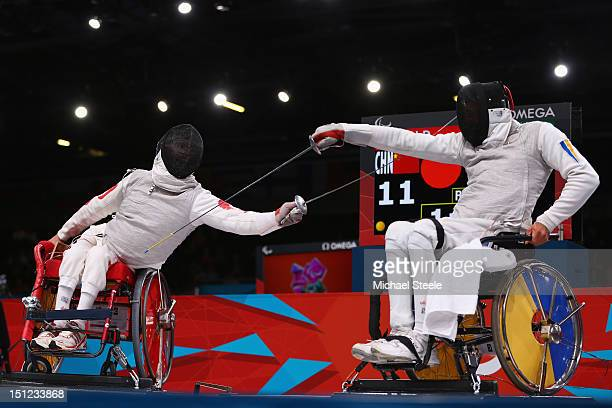 Daoliang Hu of China on his way to winning gold against Anton Datsko of Ukraine during the Men's Individual Foil Category B final of the Wheelchair...