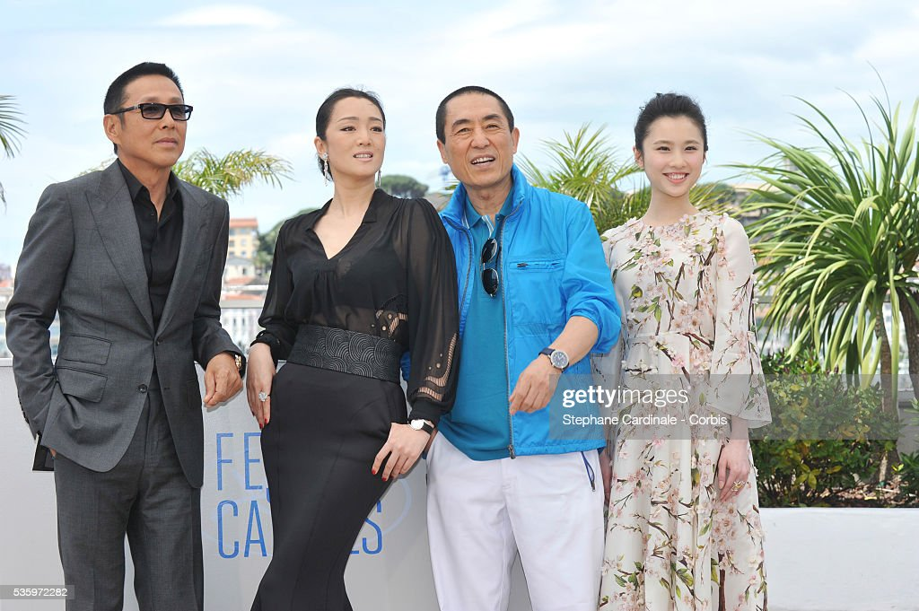 Daoming Chen, Gong Li, Yimou Zhang and Huiwen Zhang attend the 'Coming Home' photocall during 67th Cannes Film Festival